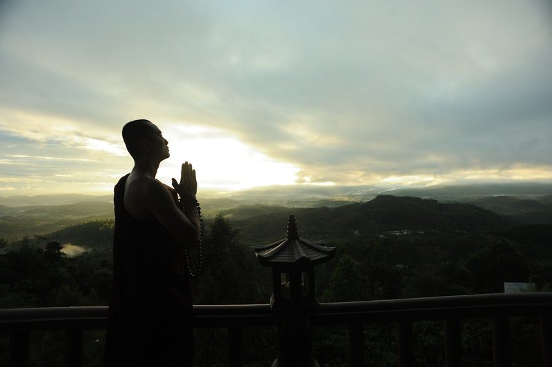 Image of a monk demonstrating the power of prayer