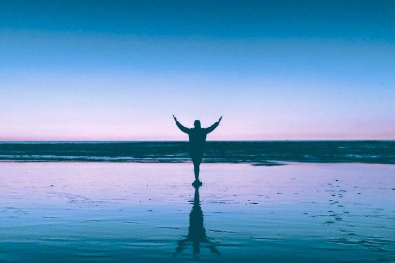 Image of a person raising up their hands and demonstrating the power of prayer