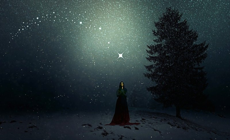 Image of a woman in the snow at night with a star omen above her head
