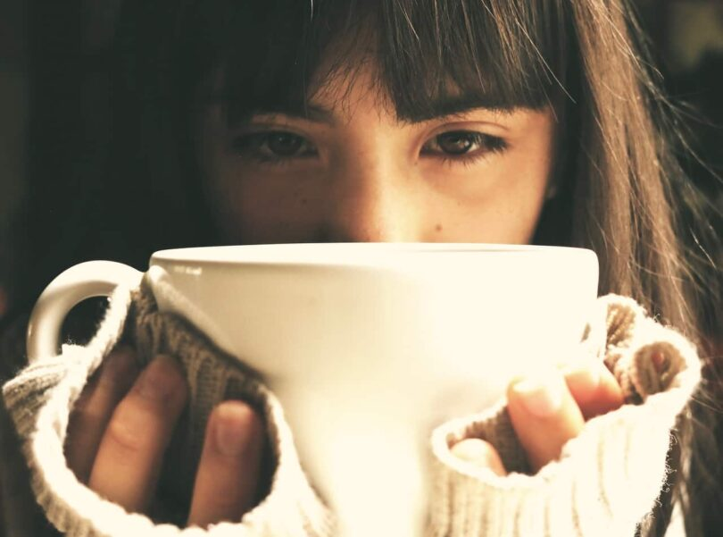Image of a depressed woman drinking tea in therapy
