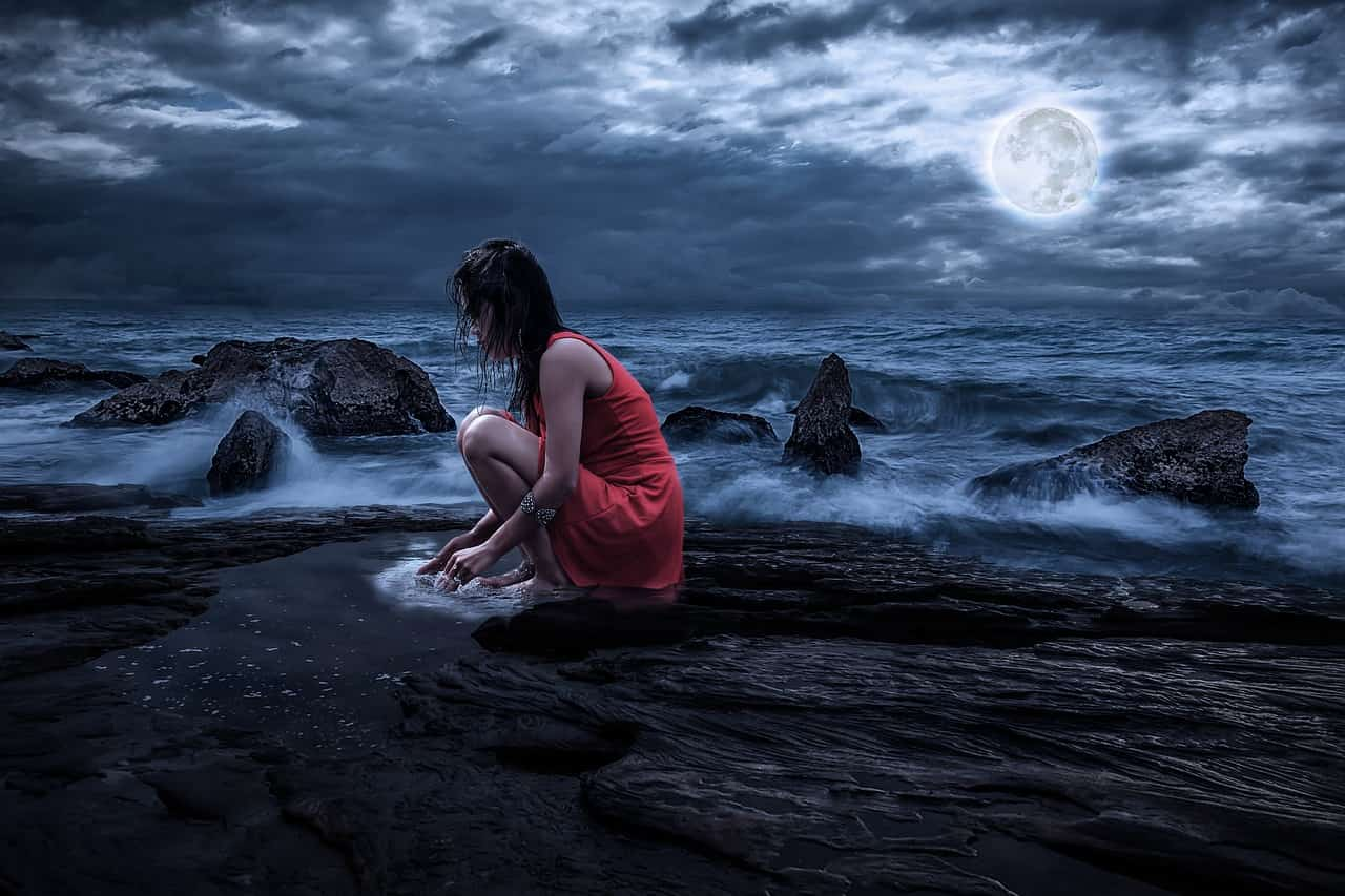 Image of a woman and the moon suffering from soul loss needing soul retrieval