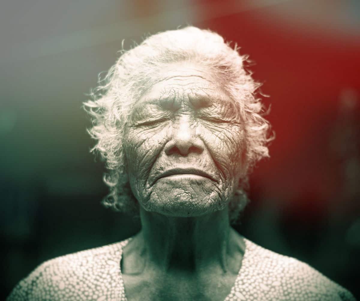 Image of a wise old spiritual elder woman with her eyes closed