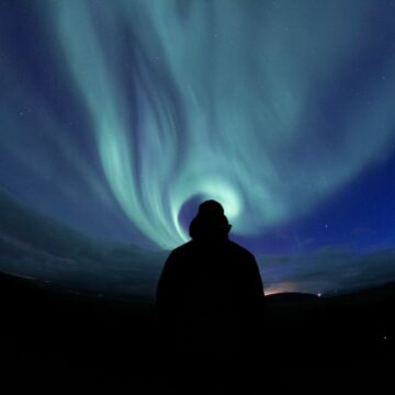 Image of a man watching the aurora borealis symbolic of doing inner work