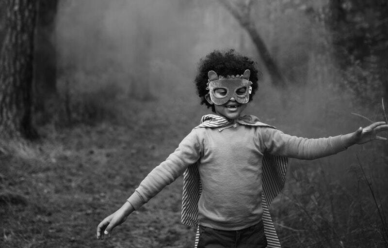 Image of a happy child running in an animal costume