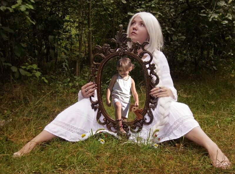 Image of a woman holding a mirror
