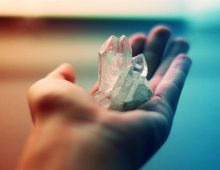 Image of a powerful quartz crystal in a person's hand