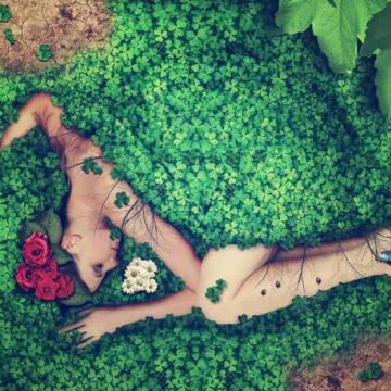 Image of an empath woman lying down on the cleansing grass