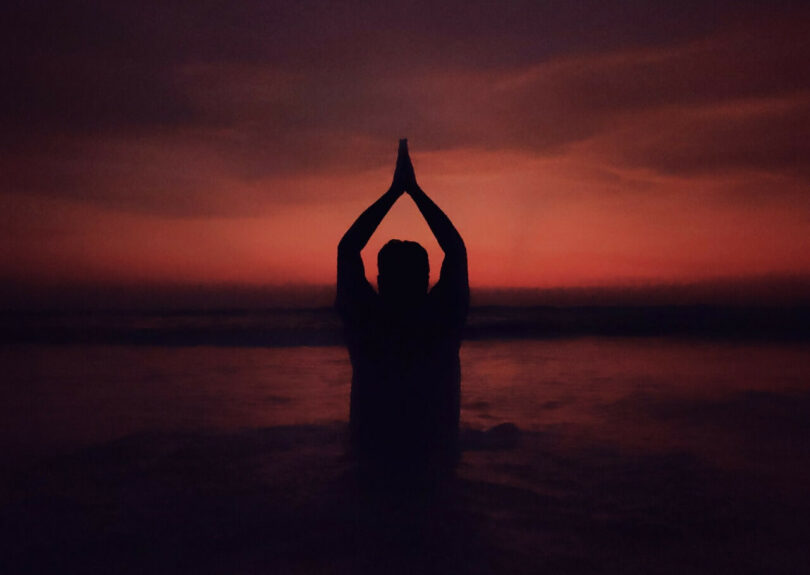 Image of a person at sunset doing mindfulness exercises