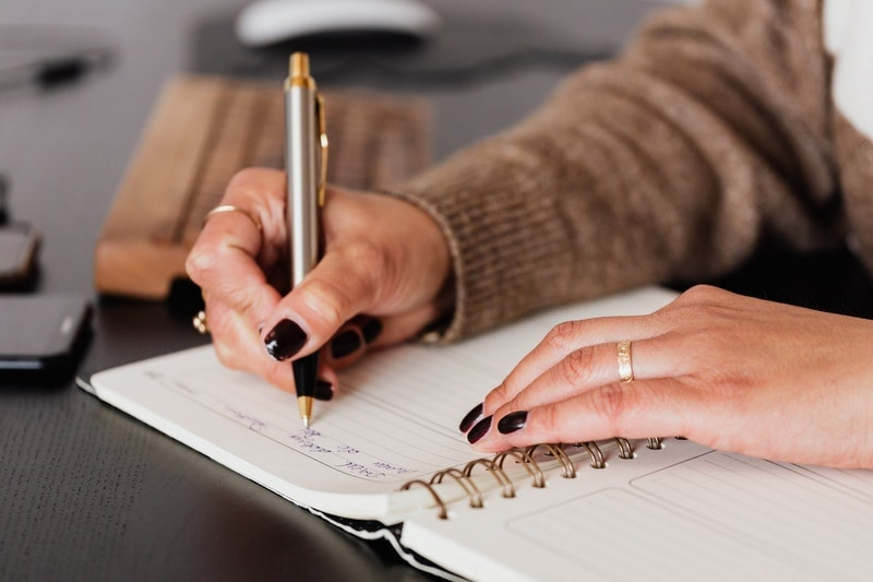 Image of a woman doing intuitive automatic writing to reconnect with her soul