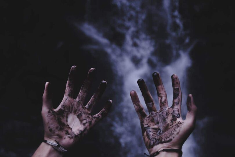 Image of dirty hands symbolic of soul searching