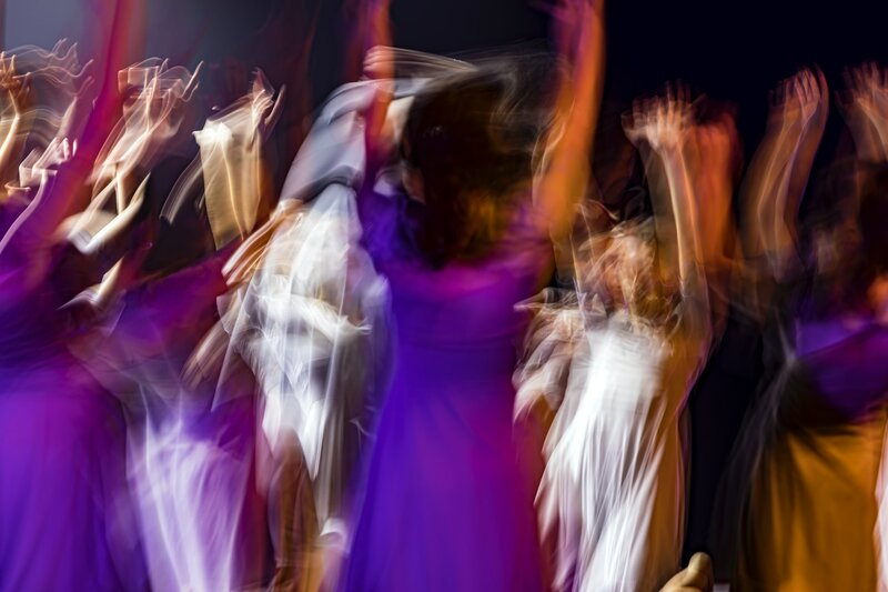 Image of a group of kindred people dancing together