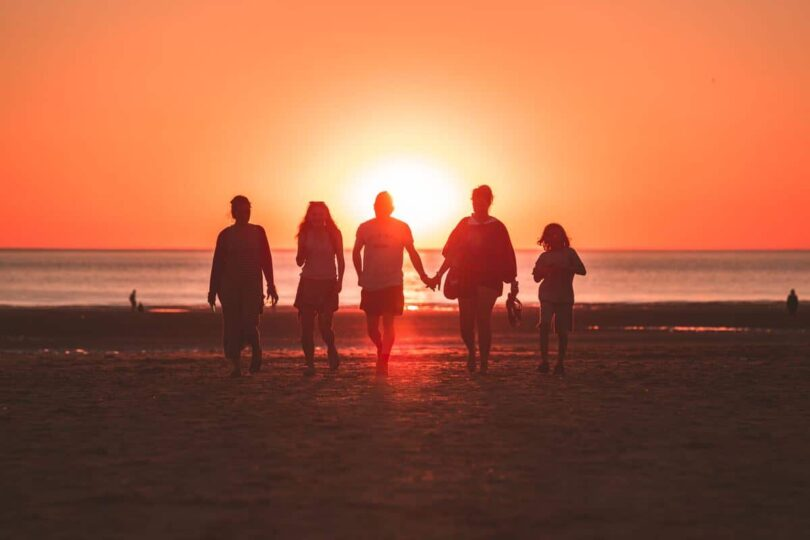 Image of a soul group walking together with the sunset in the background