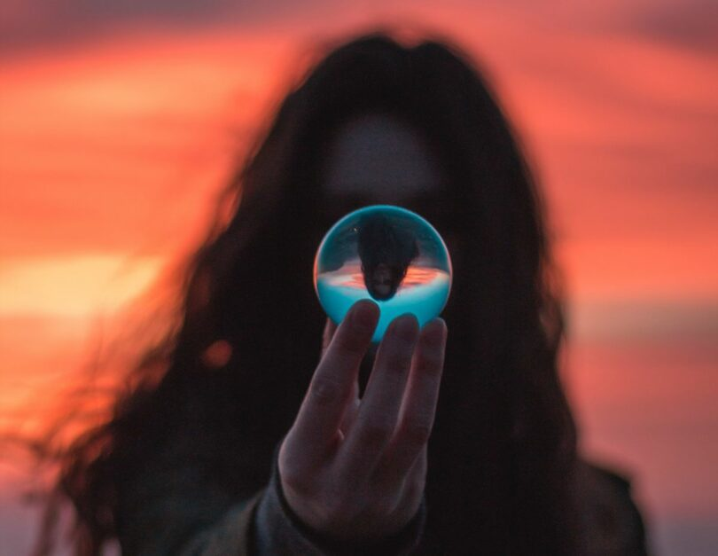 Image of a shaman holding up a crystal ball