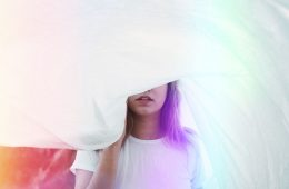 Image of a woman spiritually escaping underneath a white sheet