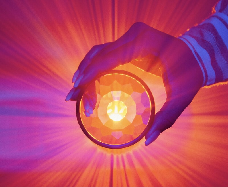Image of bright pink light coming through a crystal globe