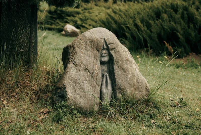 Image of a rock carved with an image of a person praying