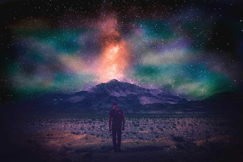 Image of a man in a cosmic landscape heeding the warning signs from the universe