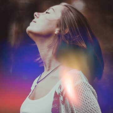 Image of a woman stretching her neck during throat chakra healing
