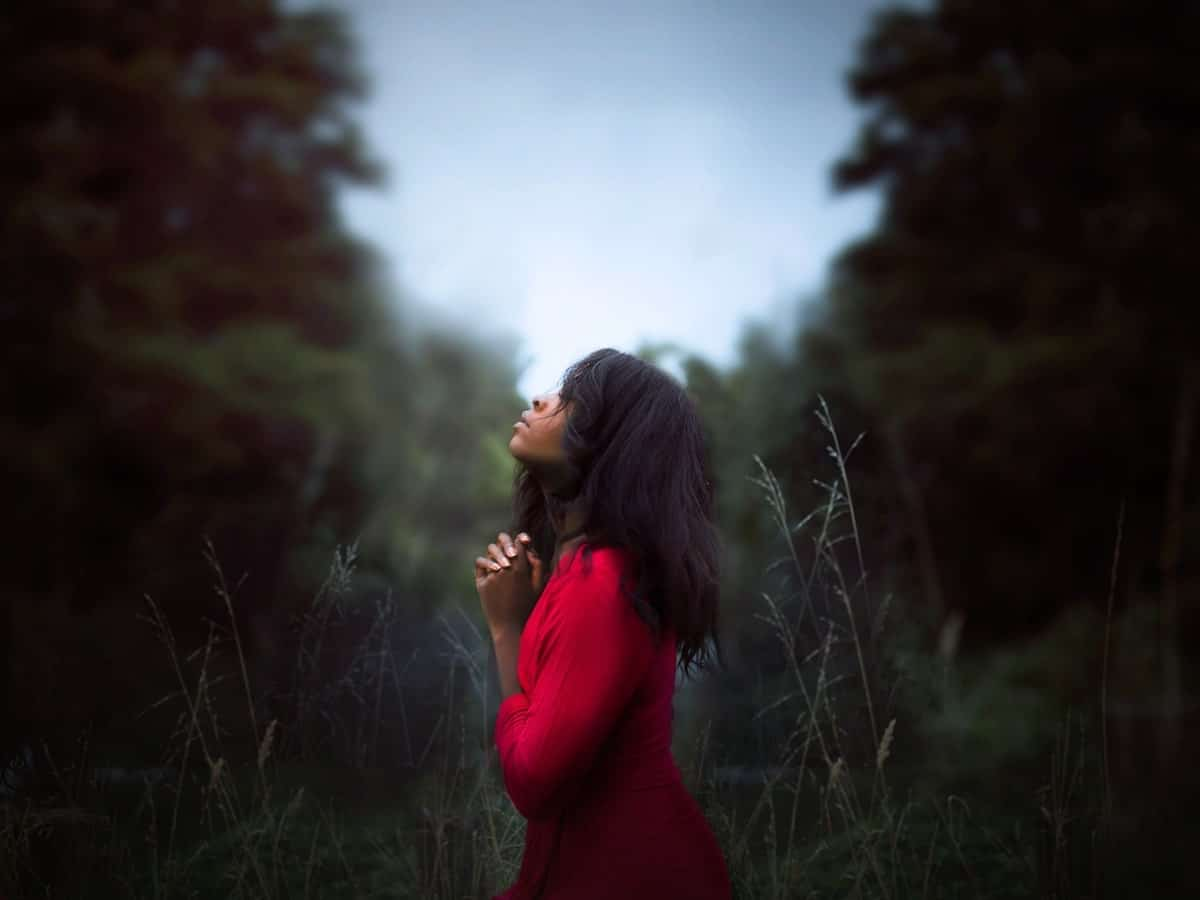 Image of a woman praying and showing gratitude