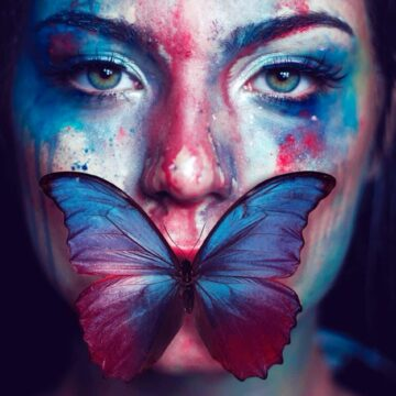Image of a woman with a butterfly on her face symbolizing inner strength