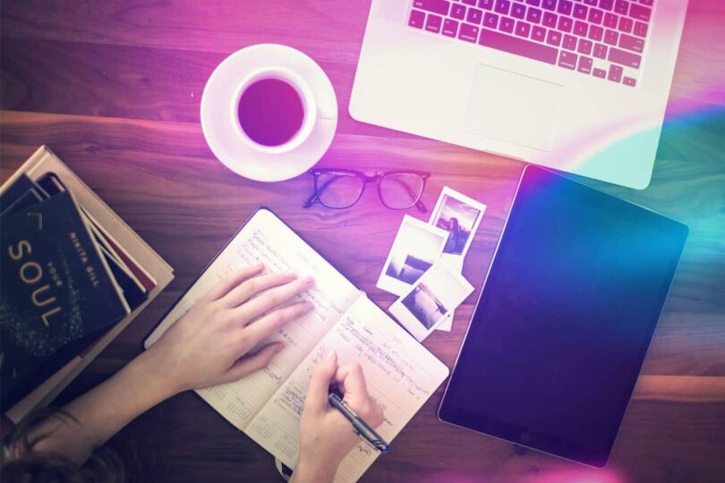 Image of a woman journalling on her desk