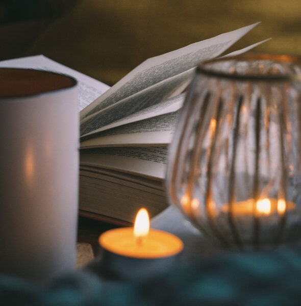 Image of a journal next to a candle