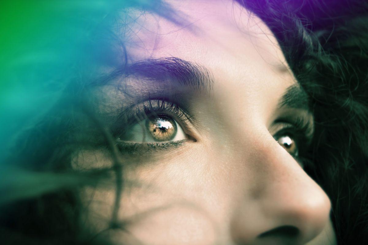 Image of a woman's eyes symbolic of the third eye chakra