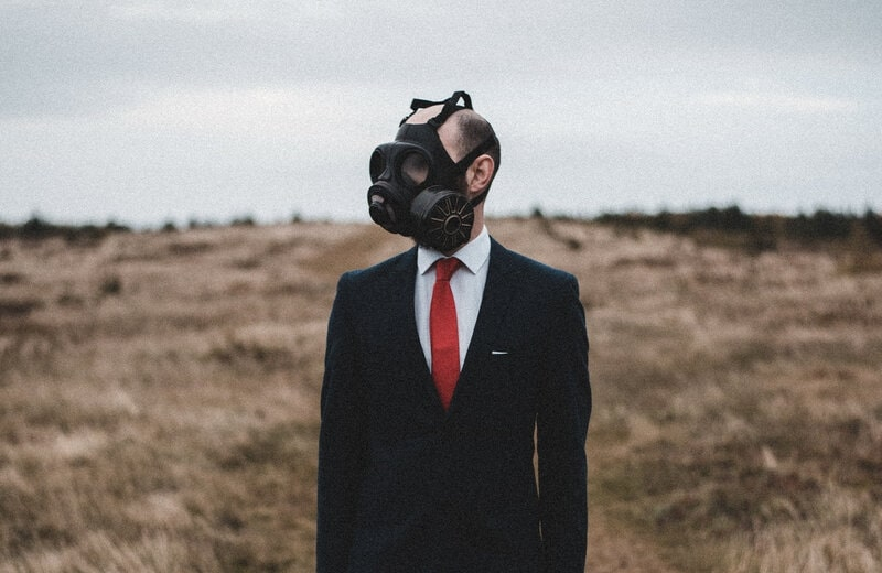 Image of a man wearing a gas mask
