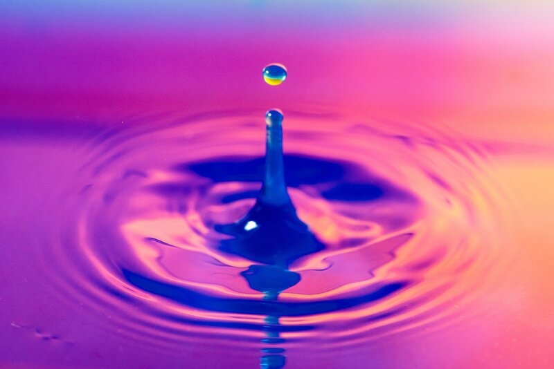 Image of a water dropping into a pink pond representing how to be true to yourself