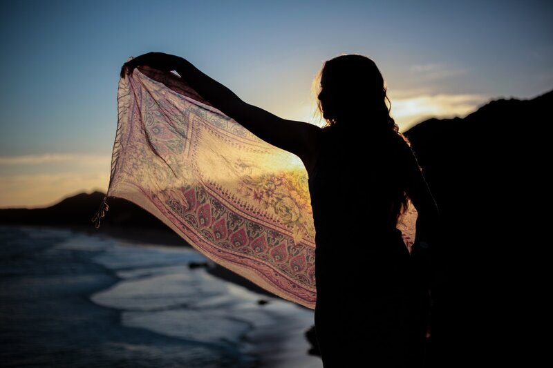Image of a woman waving a shawl in the wind