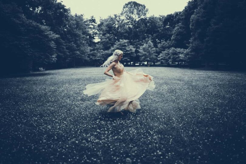 Image of a woman dancing wildly learning to be true to yourself