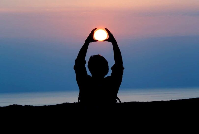 Image of a man and the sun setting symbolizing spiritual healing