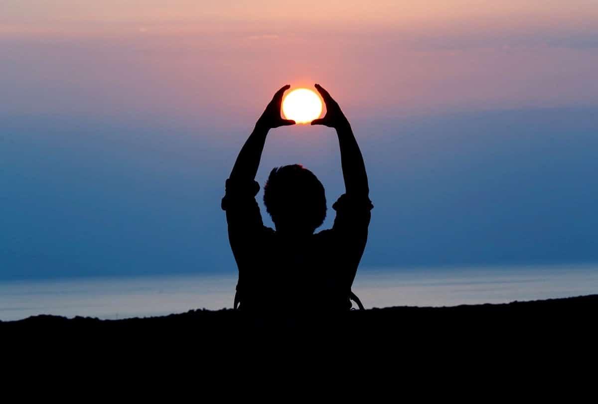 Image of a man and the sun setting symbolizing spiritual healing