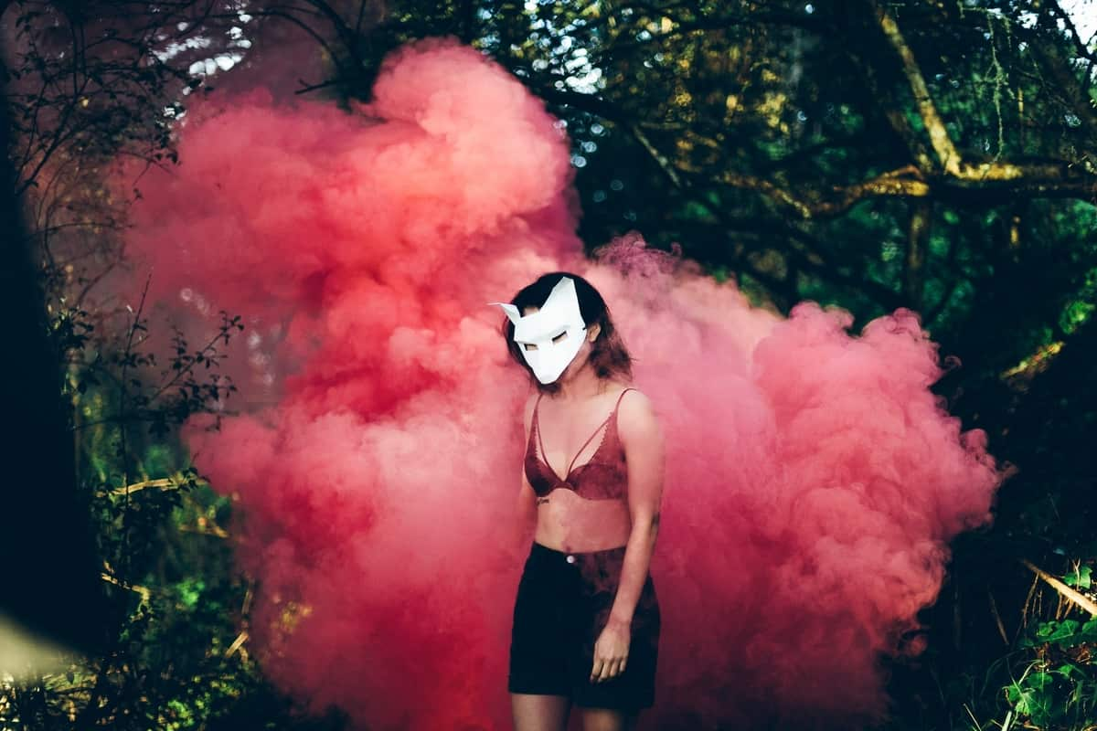 Image of a wild wolf woman in billowing smoke