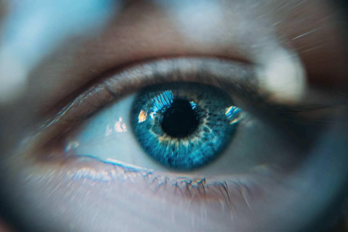 Image of a blue eye experiencing self-awareness
