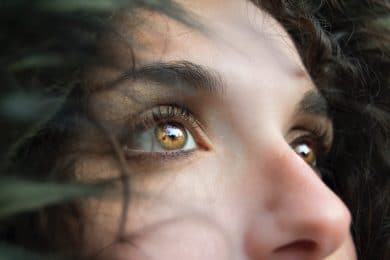 Image of a woman's eyes experiencing self-awareness