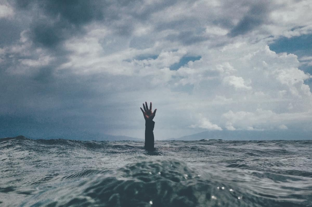Image of a man stranded in the ocean struggling to emotionally regulate