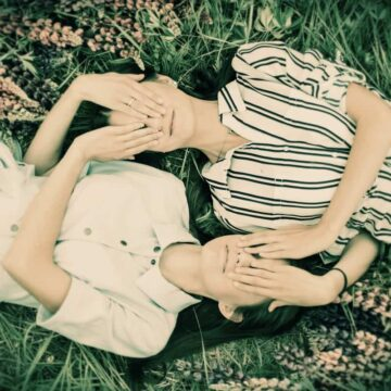 Image of two sisters in a field experiencing toxic enmeshment
