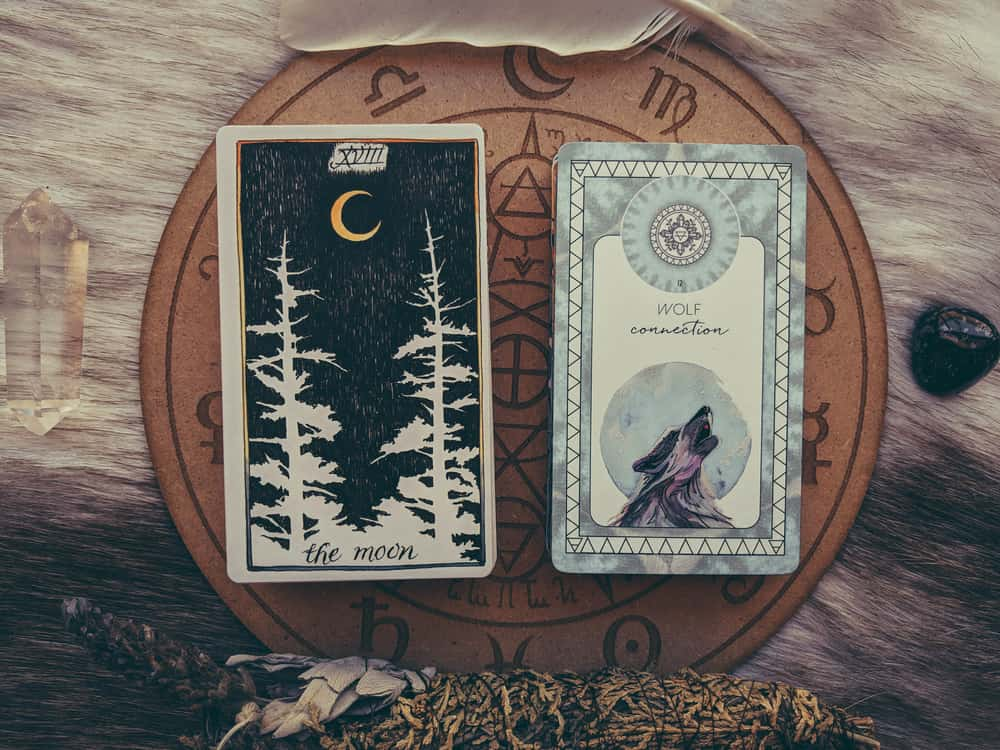 Difference between oracle and tarot decks image