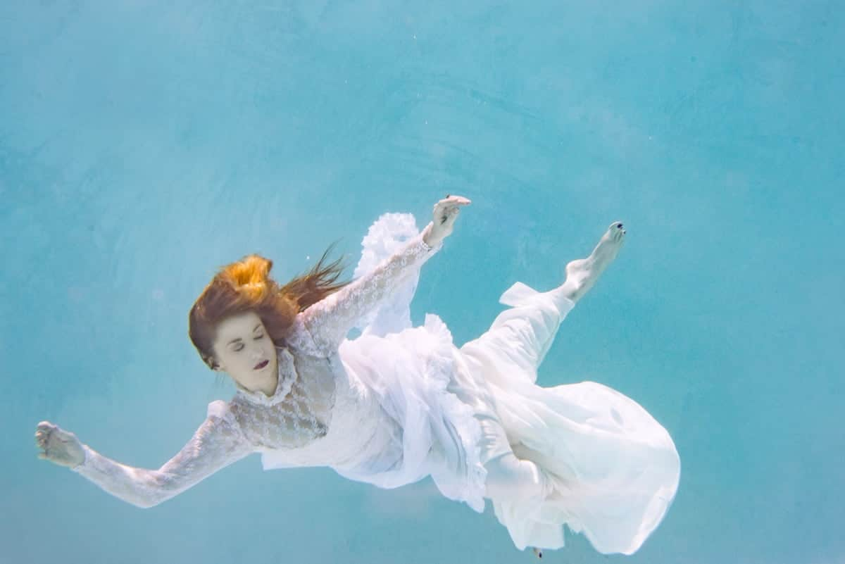 Image of woman floating in water listening to gut instincts