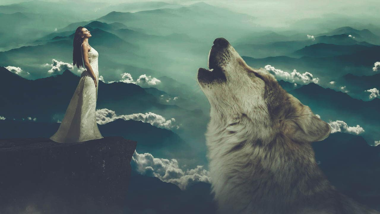 Image of a free spirit woman and a wolf howling