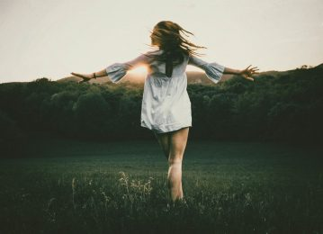 Image of a free spirit woman in nature running