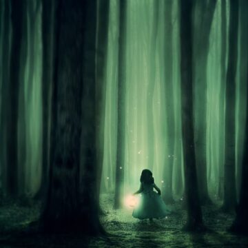 Image of a girl walking through dark forest symbolizing inner work