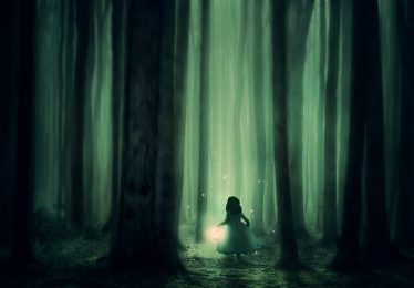 Image of a girl walking through dark forest symbolizing inner work