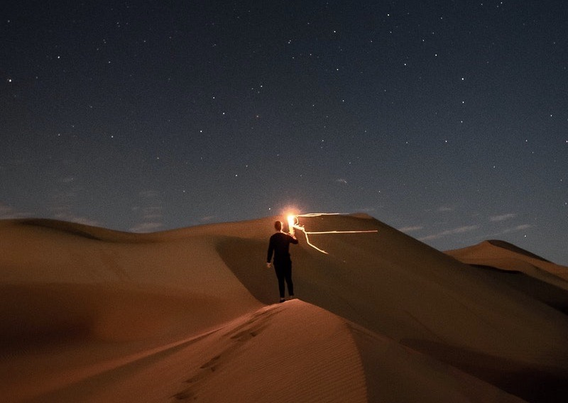 Image of a man feeling alone in a desert