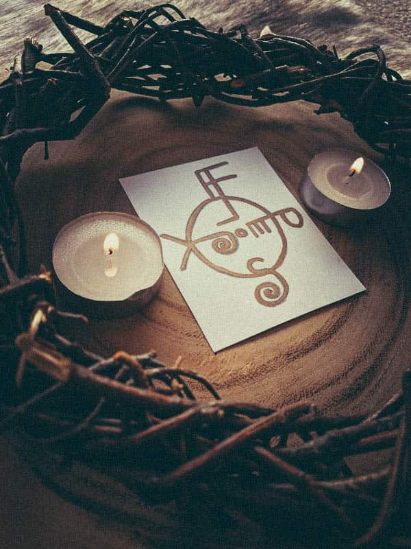 Image of a sigil and candles