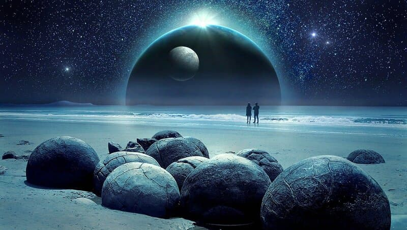 Image of two people on a mystical beach trying to interpret synchronicity