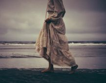 Image of a lost woman on the beach