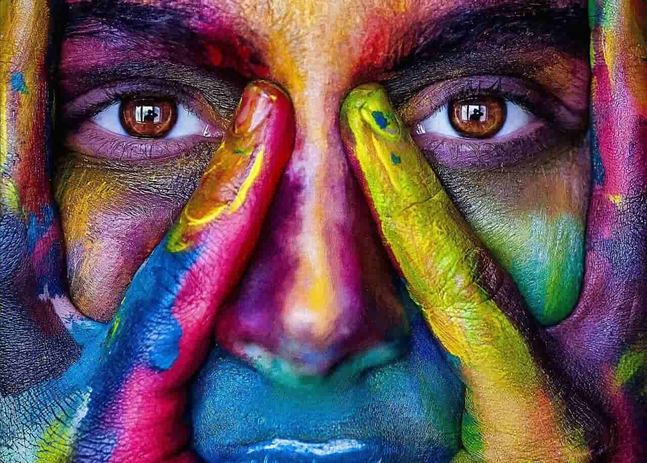 Image of an artistic colorful woman thinking of some art therapy ideas