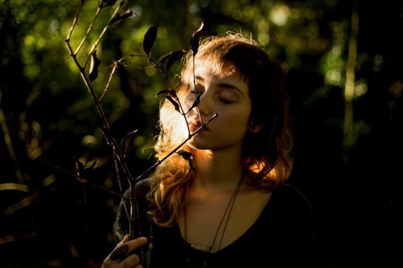 Image of a woman in nature soul searching